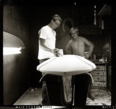 1966  Bruce Jones and Jackie Baxter shaping the Jackie Baxter Model at Vardeman Surfboards on PCH in Huntington Beach, across the street from the pier..   Photo taken with a 2 1/4 Zeiss Super Iconta B, Pre-WWII German camera.