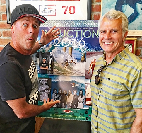 Bob Hurley and Lew Harrison in front of SWoF Inductee Poster